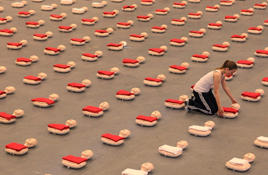 A girl arranges a reanimation doll in Li